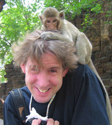 Ian Lloyd, being harassed by a monkey with a hair fetish